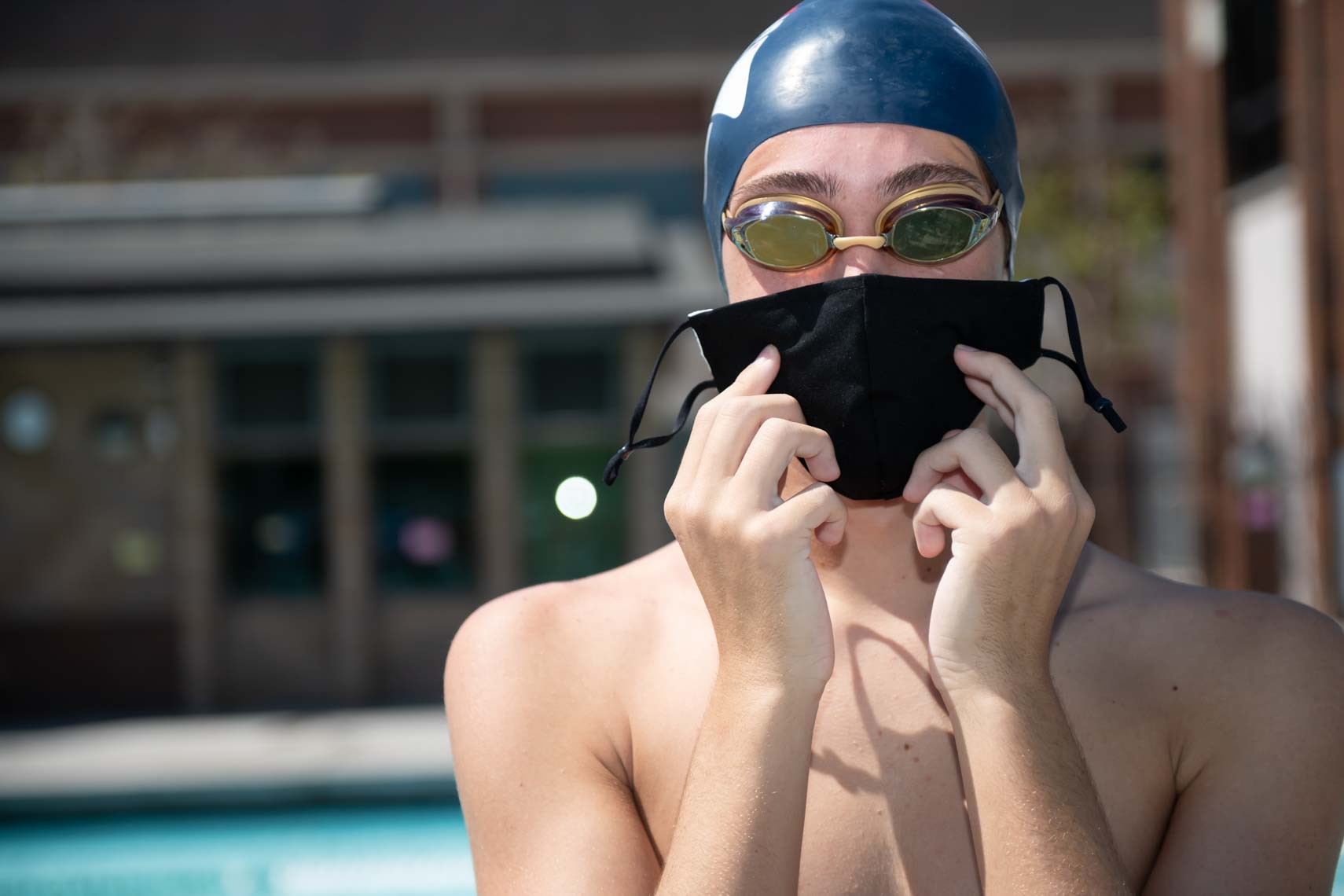 age group swimmer with face mask by Mike Lewis