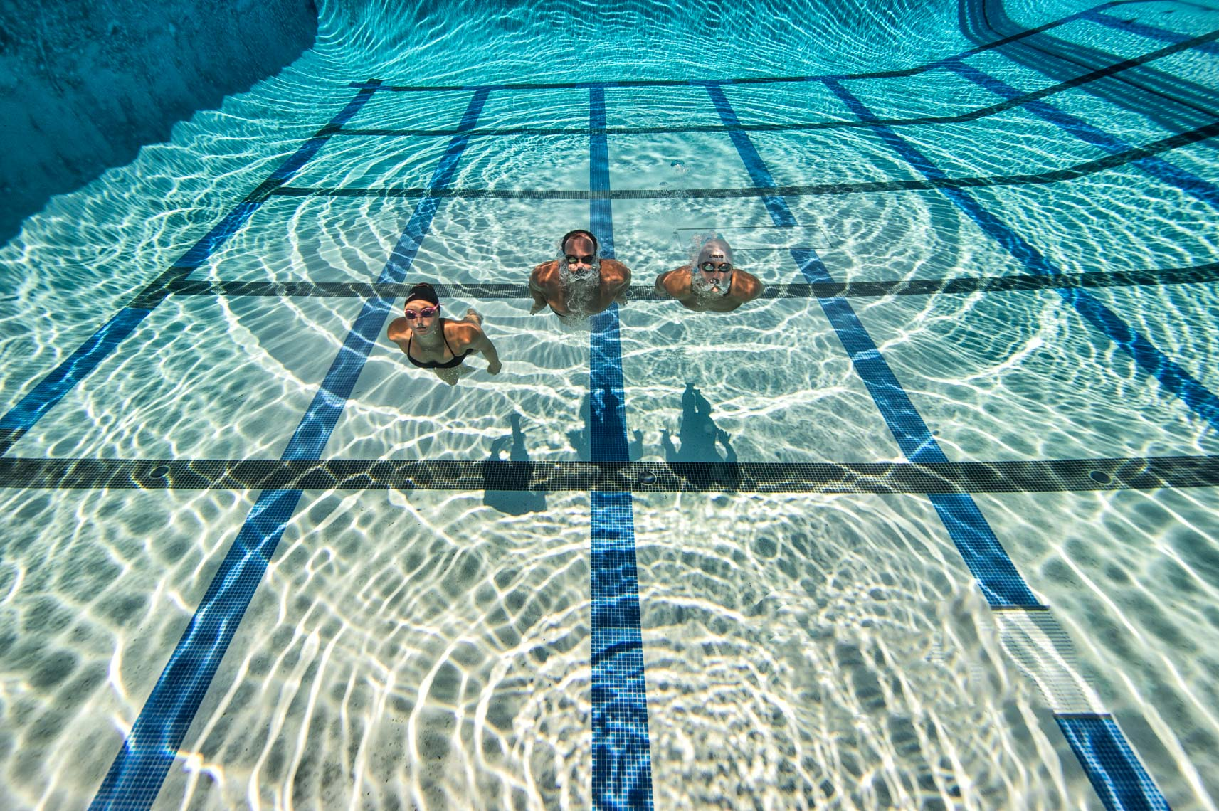 family swimming underwater