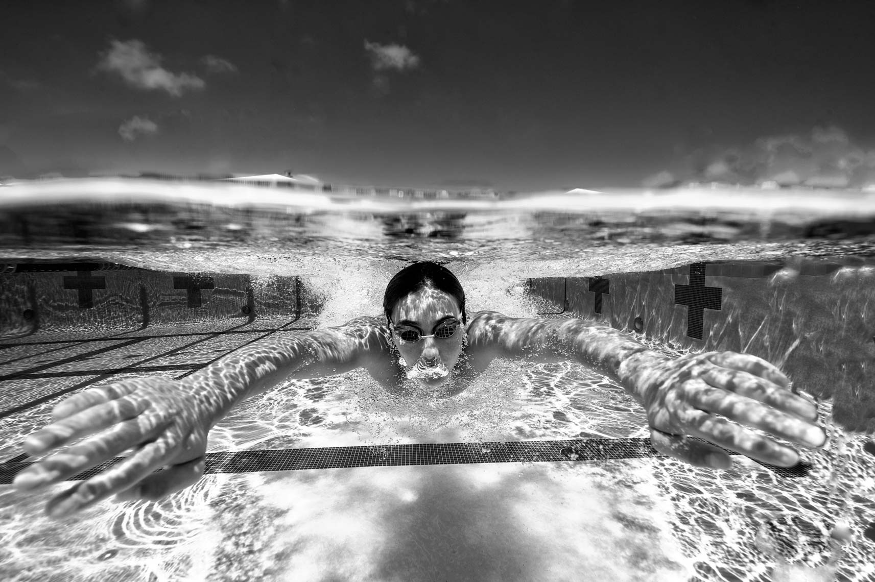 underwater swimmer black and white